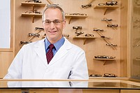 Male optician behind counter