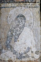 Fresco of Buddha on the wall of a cave, Ajanta, Maharashtra, India