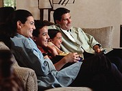 Family in living room watching television