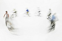 People riding bicycles blurred motion