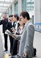 Business executives waiting for taxi at an airport