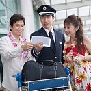 Mature couple showing their airplane tickets to a pilot