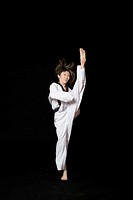 Young woman performing front kick