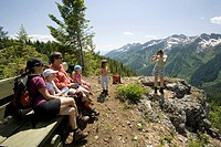 Two families enjoy viewpoint while hiking on trail at Island Lake Resort in the Lizard Range, Fernie, British Columbia, Canada