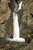 Hiking under a waterfall near gold bridge, british columbia, canada