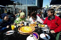 A family relaxing over lunch in whistler village, british columbia, Canada