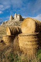 hay bails form a foreground for hoodoos just East of Kamloops British Columbia, Canada