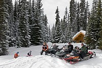A family enjoys snowmobiling at Sun Peaks Ski Resort, North of Kamloops, British Columbia, Canada