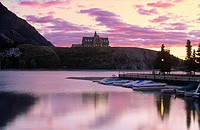 Historic Prince of Wales Hotel at sunset located above Waterton Lake in Waterton Lakes National Park, Alberta, Canada