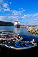 Coastal boat docked at Rigolet with dories in foreground, Labrador, Newfoundland, Canada