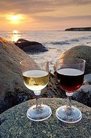 The rocky shoreline of Green Point and wine glasses at sunset, Gros Morne National Park, UNESCO World Heritage Site, Viking Trail, Great Northern Peni...