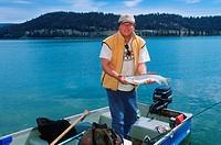 Stump Lake, between Merritt and Kamloops  Rainbow trout and fisherman, British Columbia, Canada
