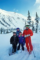 family poses on backside of Blackcomb mountain, Whistler, British Columbia, Canada