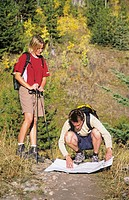 Hikers checking a map, Canadian Rockies, British Columbia, Canada