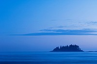 fog shrouded Islet, MacKenzie Beach at Tofino, Vancouver Island, British Columbia, Canada