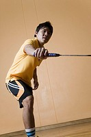 Side profile of a young man playing badminton