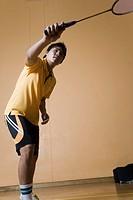 Young man playing badminton