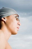 Close-up of a young man wearing swimming goggles