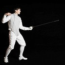 Male fencer holding a fencing foil
