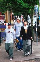 Skateboarders Downtown on Street Corner