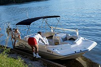 A couple mooring their boat in Bellville, Michigan USA