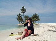 Woman on Cell Phone on Beach, Belize