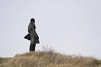 Woman Standing on Dunes, Island Schiermonnikoog, Netherlands