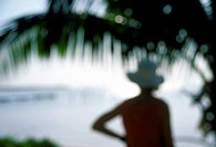 Woman´s Silhouette by Palm Tree, Caye Caulker, Belize