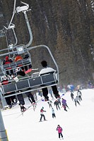 Snowboarders and Skiers on Chair Lift, Alberta Rocky Mountains Not