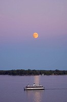Moon rise and Toronto Island Ferry on Lake Ontario, Toronto Ontario