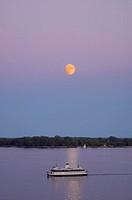 Moon rise and Toronto Island Ferry on Lake Ontario, Toronto Ontario
