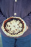 Holding a Homemade Pie
