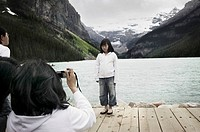 Tourist Photographing Lake Louise, Alberta