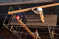 Dock Workers on a Scaffolding