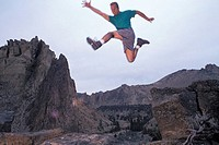 Man Jumping Off a Rock