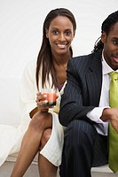 African woman sitting next to husband