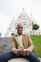 African man holding camera