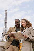 African couple looking at map