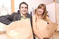Caucasian Couple Happy With Their Purchases At A Trendy Boutique