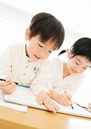 Sister and Brother Drawing a Picture