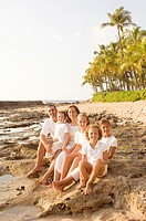 Family Sitting on Hawaiian Beach