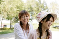 Smiling young women in the park
