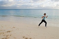 Young woman jogging at beach