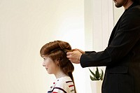 Hairdresser Putting Curlers in Woman´s Hair