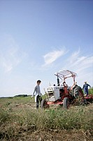A tractor and a father and children