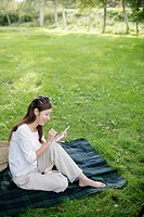 A woman using the portable game device