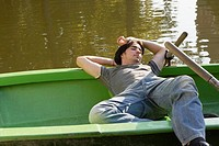 Man sleeping in a rowboat