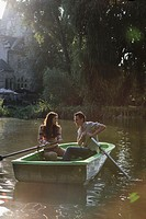 Couple in a rowboat smiling