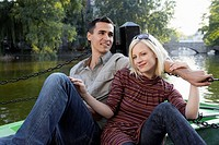 Couple on a dock smiling and relaxing