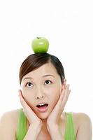 Woman with an apple on head
